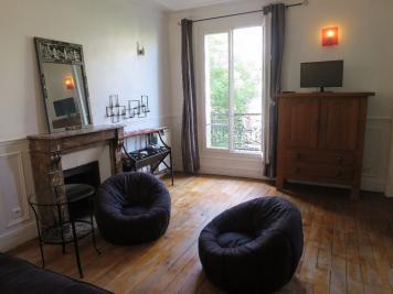 Appartement Paris 18 &bull; <span class='offer-area-number'>57</span> m² environ &bull; <span class='offer-rooms-number'>2</span> pièces